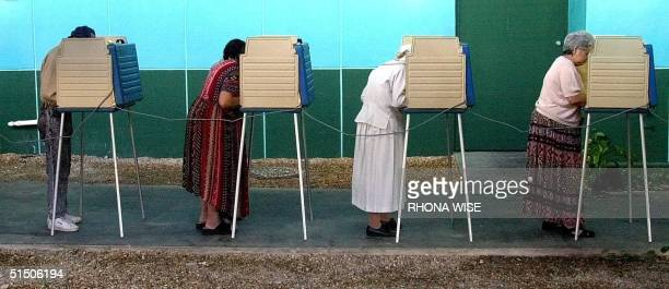 Cuban Americans vote at a pollng center 07 November 2000 in Miami's Little Havana Florida Florida is predicted to be one of the states that could...