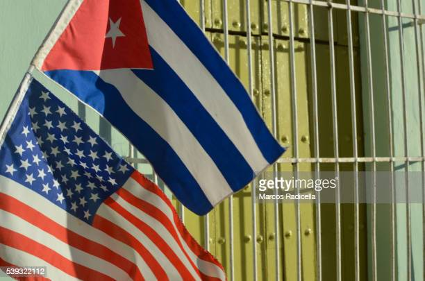 cuban and american flag at remedios, cuba - santa clara cuba stock pictures, royalty-free photos & images
