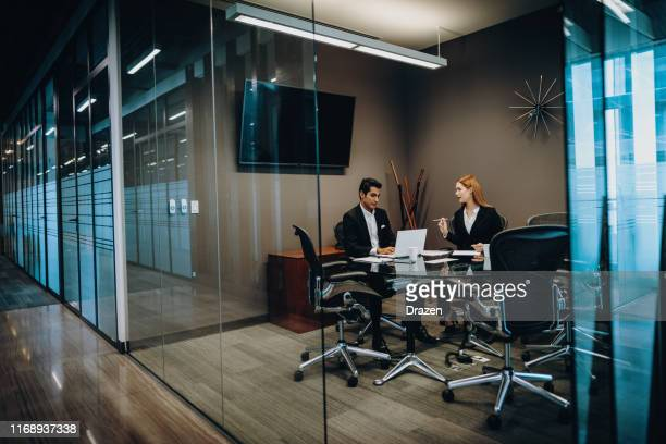 cuban and mexican business people using internet for business correspondence and analysis. - bank manager stock pictures, royalty-free photos & images