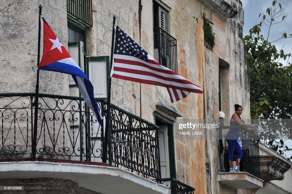 Cuban and US flags are seen on balconies in Havana on March 20, 2016. On Sunday, Obama became the first US president in 88 years to visit Cuba, touching down in Havana for a landmark trip aimed at ending decades of Cold War animosity.