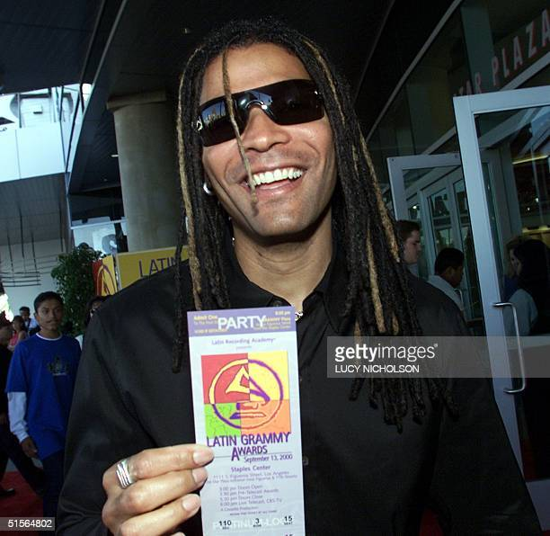 Cuban artist Amaury Gutierrez shows off his ticket as he arrives at the first annual Latin Grammy Awards at the Staples Center in Los Angeles 13...