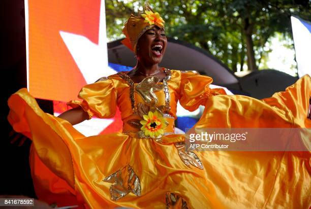 A Cuban artist dances Rumba during a musical homage to the late Cuban leader Fidel Castro on September 1 2017 in Havana / AFP PHOTO / YAMIL LAGE