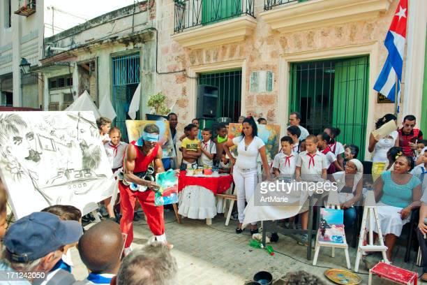 Cuban artist painting for schoolchildren
