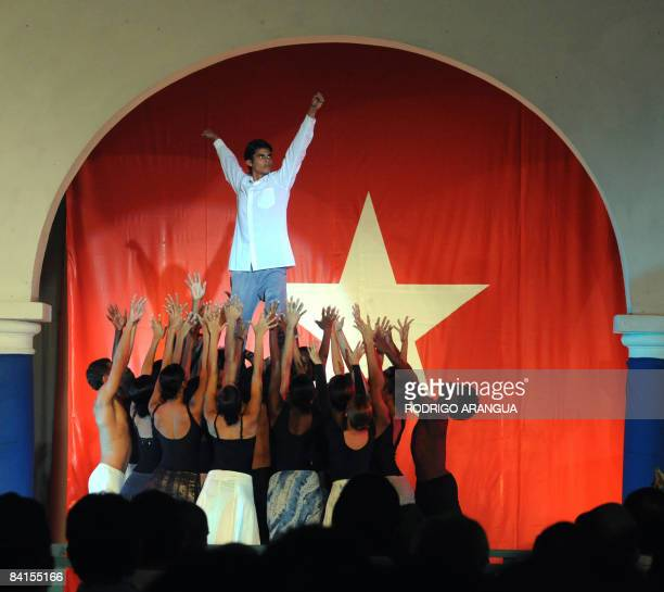 Cuban artists perform on stage on January 1 2009 during the celebration of the 50th anniversary of the Cuban Revolution in Santiago de Cuba Communist...