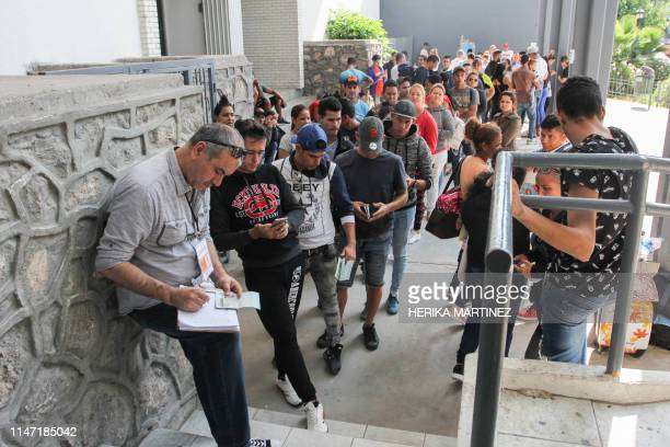 Cuban asylum seekers queue for a turn for an asylum appointment with US authorities in Ciudad Juarez Chihuahua state Mexico on May 31 2019 Washington...
