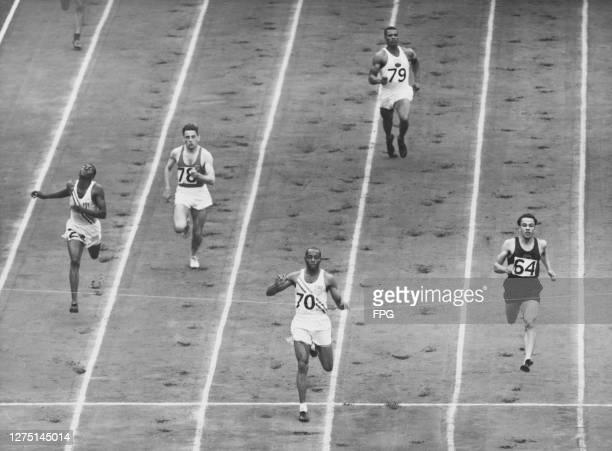 Cuban athlete Angel Garcia , Belgian athlete Fernand Linssen , American athlete Barney Ewell , Bermudian athlete Hazzard Dill , and South African...