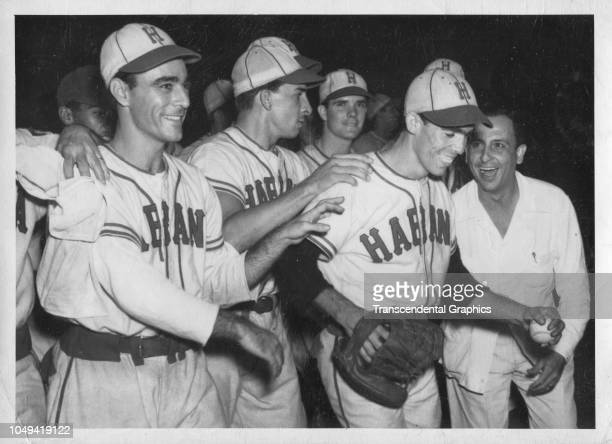 Cuban baseball player Daniel Parra celebrates with his teammates after a shutout Havana Cuba circa 1940