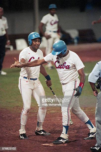 A Cuban baseball player is congratulated by his teammate after scoring a homerun during an Olympic game against the United States | Location...