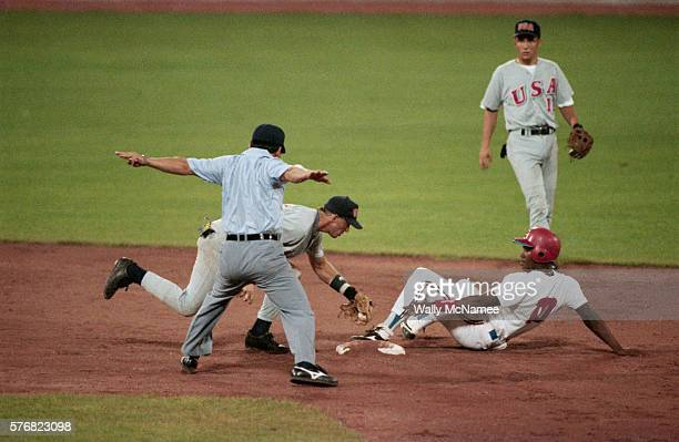 A Cuban baseball player slides into base safely during an Olympic baseball game against the United States | Location Barcelona Spain