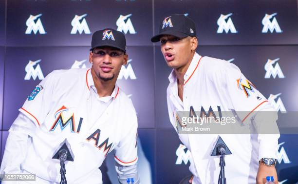 Cuban baseball players and brothers Victor Victor Mesa and Victor Mesa Jr meet with members of the media to announce the signing of the Mesa brothers...