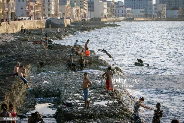 Cuban bather's off the Malecon Havana