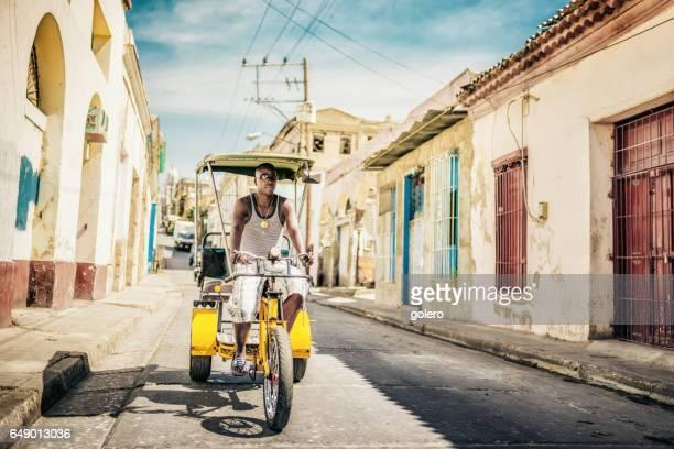 cuban bike-taxi driver in old Santiago de Cuba