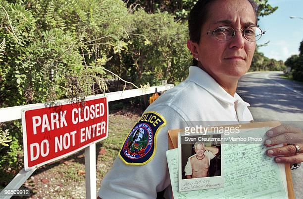 Cuban born Nelia Real police officer in Key Biscayne holds the detention report of Gregory Hemingway on September 24 in Miami USA Real detained the...