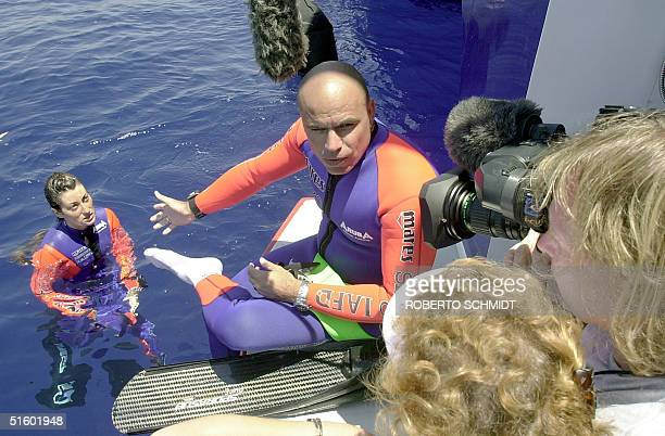 Cuban born Pipin Ferreras points to her wife Frenchwoman Audrey Mestre Ferreras as he speaks with a National Geographic TV crew after the Ferreras...