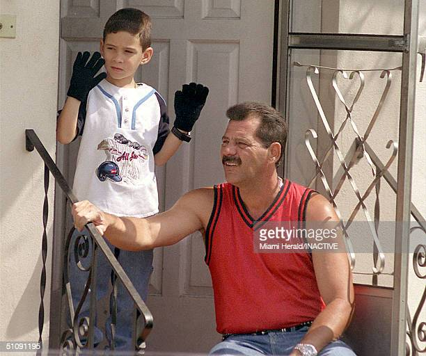 Cuban Boy Elian Gonzalez With His Uncle Lazaro Gonzalez Waves To Supporters Gathered Outside His House April 9 2000 In The Little Havana Section Of...