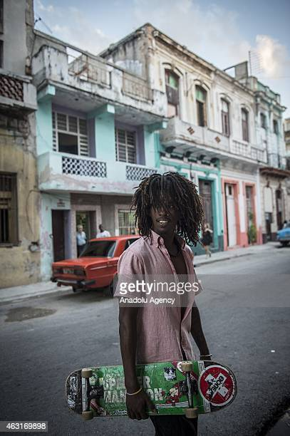 Cuban boy is seen with his skateboard at a street in Havana capital city of Cuba on February 9 2015 Cubans continue their daily life during talks...