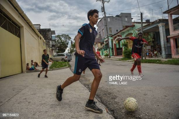 Cuban boys play football on a street in Havana, on July 12 three days ahead of the FIFA World Cup final match between France and Croatia in Russia.