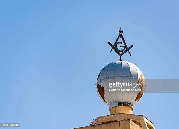Cuban buildings Freemasonry symbol built on globe fixed on a building in Cuba The logo symbolizes masonic lodge A masonic lodge often termed a...