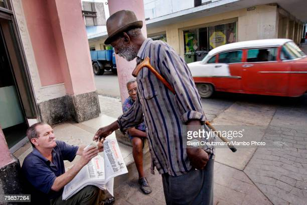 Cuban buys the official communist party newspaper Granma which published a resignation by President Fidel Castro as President and CommanderinChief...