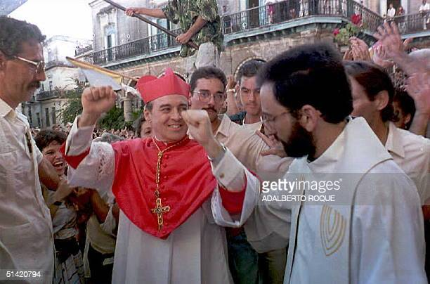 Cuban Cardinal Jaime Ortega greets people outside the Church of the Cathedral in Havana upon his arrival 11 December 1994 Ortega who was nominated to...