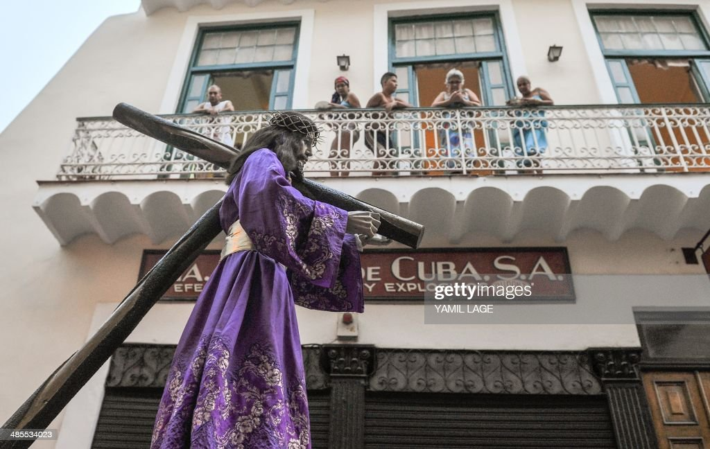 Cuban Catholics participate in the Via Crucis along the streets of Havana during Good Friday on April 18, 2014.