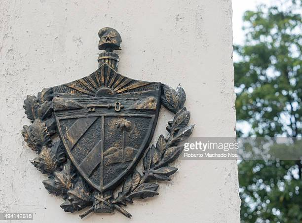 Cuban coat of arms Details of the Monument ot the revolutionary martyrs of the Sancti Spiritus province Each column shows a list of the fallen during...