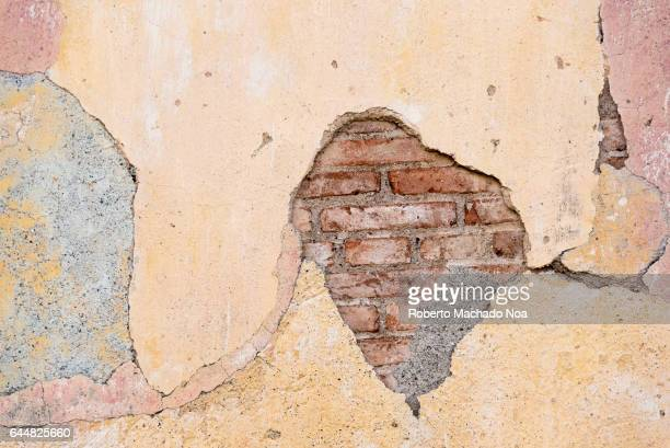 Cuban colonial weathered architecture details Cracks in an old brick wall Economic hardship has forced many people to keep their property without...