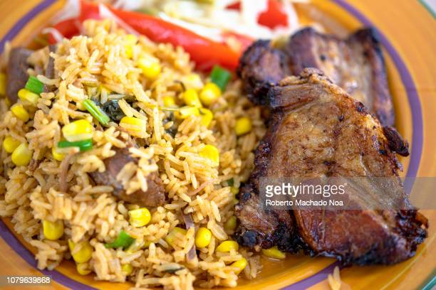 cuban cuisine: deep pork fried and yellow rice - creole culture stock pictures, royalty-free photos & images