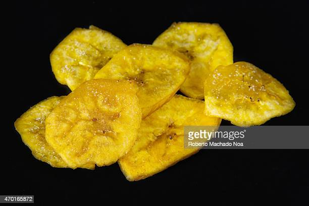 Cuban Cuisine delicious green plantain salty chips or fries served for snack in a blue plate Green plantain chips or fries are part of the Cuban...