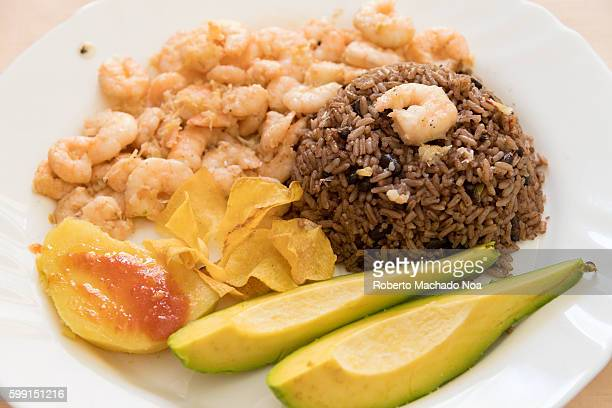 cuban cuisine: garlic shrimp with avocado, congri rice and fried sweet potatoes - santa clara cuba stock pictures, royalty-free photos & images