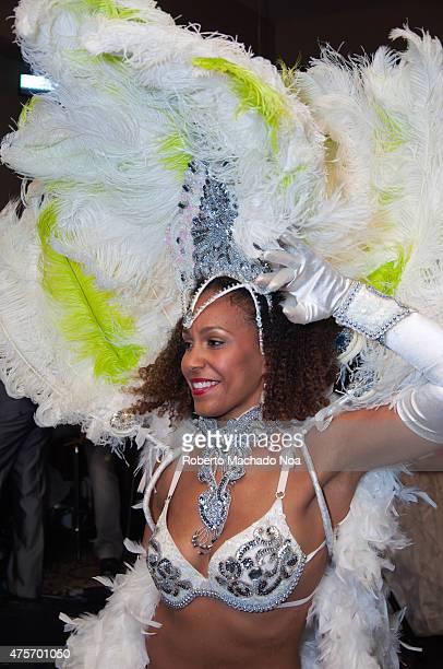 Cuban dancer Carnival dancer woman dancing in a beautiful festive costume of white feathers