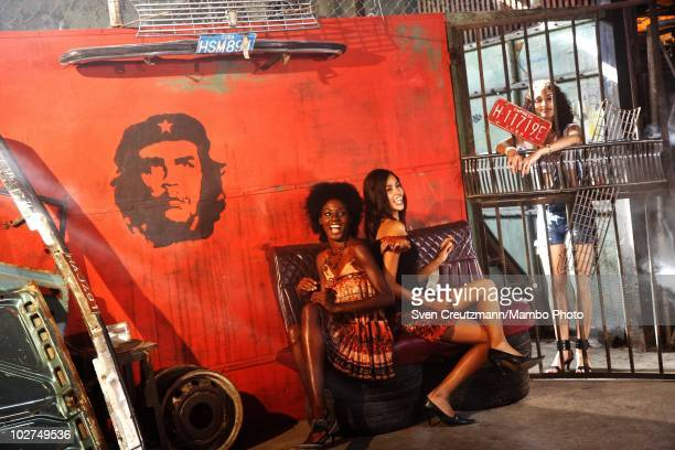 Cuban dancers and models of the KINGS OF SALSA, a show by british theater director Jon Lee, pose during a photoshoot in a garage against the backdrop...