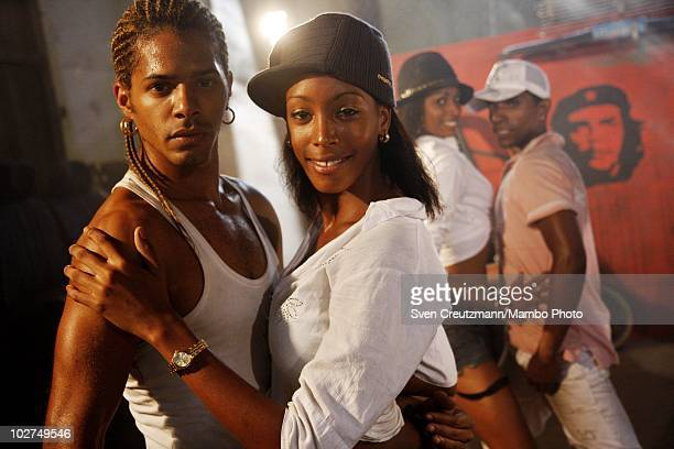 Cuban dancers of the KINGS OF SALSA, a show by british theater director Jon Lee, rehearse during a photoshoot in a garage against the backdrop of the...