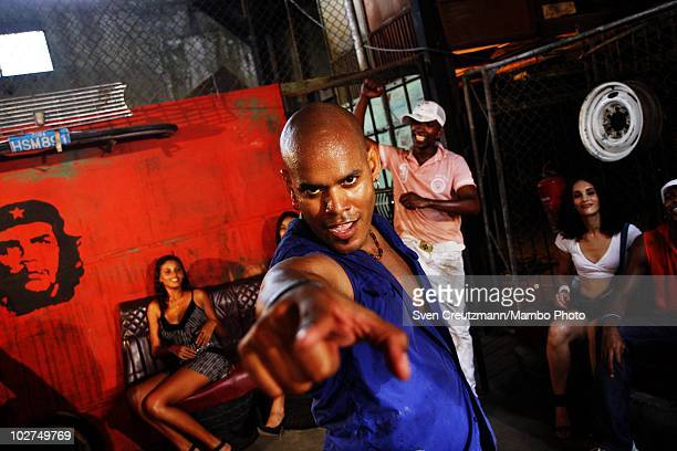 Cuban dancers of the KINGS OF SALSA a show by british theater director Jon Lee rehearse during a photoshoot in a garage against the backdrop of the...