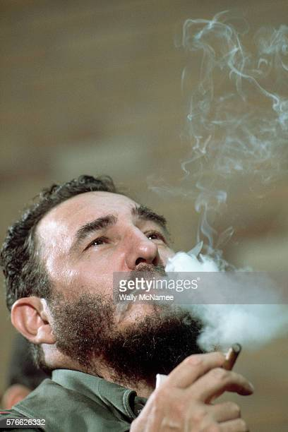 Cuban Dictator Fidel Castro exhales smoke from his Cohiba cigar during a ceremony at the Palace of Receptions in Havana