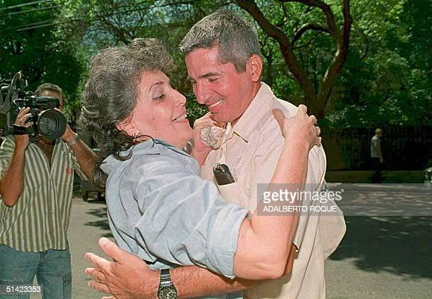 Cuban dissident Indamiro Restano embraces his wife Marcela Sanchez upon his arrival at his home after his release from a Cuban prison 01 June in...