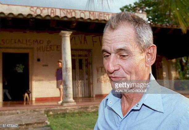 Cuban dissident Sebastian Arcos Bernes stands in frontof his house 31 May in Havana after being released from prison Arcos Bernes served three years...