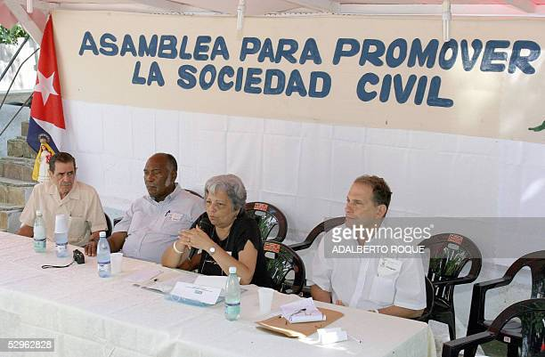 Cuban dissidents Julio Diaz Pitaluga Felix Bonne Carcases Marta Beatriz Roque and Rene Gomez Manzano chair 21 May 2005 the second day of activities...