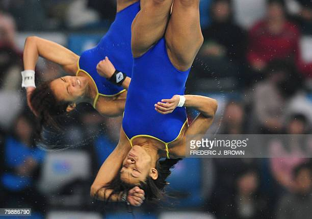 Cuban divers Yaima Mena and Annia Rivera compete in the Women's 10M Synchro PLatform on February 21 2008 during a test event at the National Aquatics...