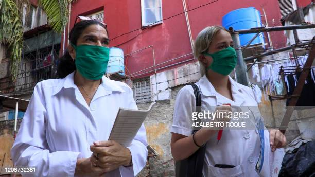 Cuban doctor Liz Caballero and student Susana Diaz leave El Vedado polyclinic in Havana to go door by door looking for possible cases of the novel...