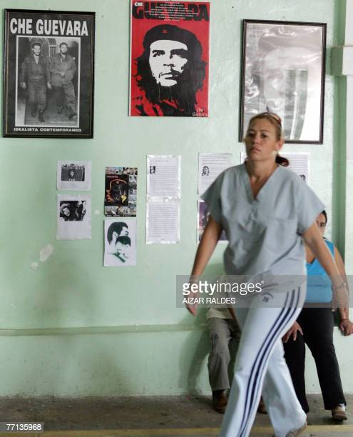 A Cuban doctor passes by a wall with posters of legendary guerrilla leader Argentineborn Ernesto Che Guevara 01 October 2007 at the Mision Milagro...