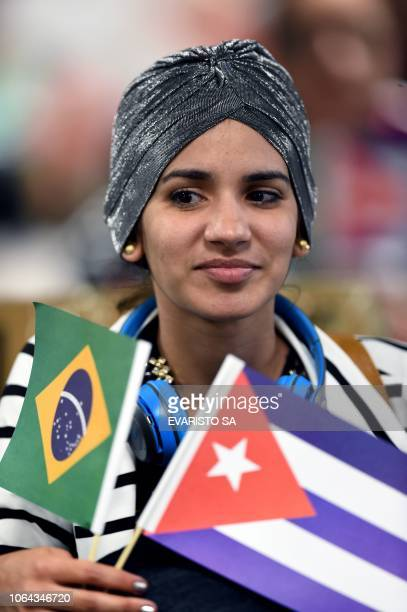 A Cuban doctor waits to checkin at Brasilia's airport Brazil to fly back to Cuba on November 22 2018 The Cuban government decided to withdraw from...