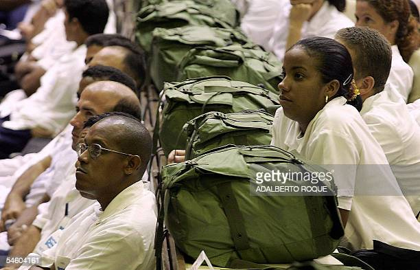 Cuban doctors listen to a speech by Cuban President Fidel Castro in Havana 04 September 2005 as he extends his offer to send 1100 Cuban doctors with...