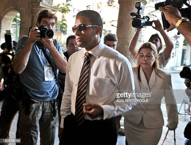 Cuban ex political prisoner Oscar Elias Biscet arrives to meet with former US president Jimmy Carter at the hotel in Havana where the latter is...