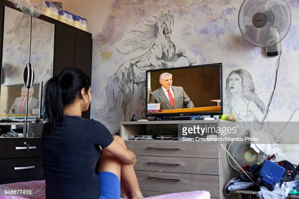 Cuban family follows the live coverage of a speech of Miguel Diaz Canel after he had been elected as the new President of Cuba on April 19 in Havana...