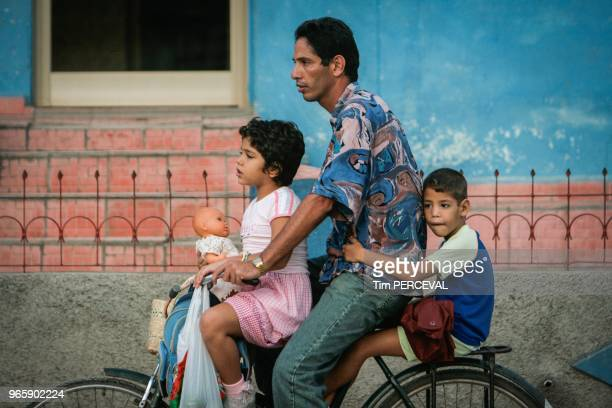 Cuban family on one bike Bayamo