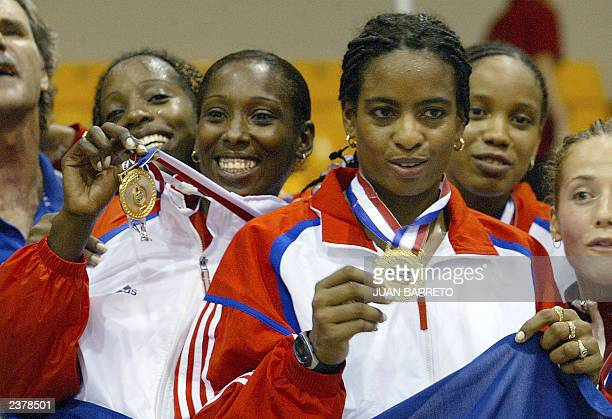 Cuban fencers Elmey Gomez Misleydis Ona Zuleydis Ortiz and Arianne Ribot show their gold medals at the XIV Pan American Games 2003 in Santo Domingo...