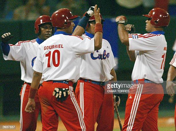 Cuban first base Kendry Morales celebrates with his teammates after hitting a homerun and pushing two other runs during the XXXV Baseball World Cup...