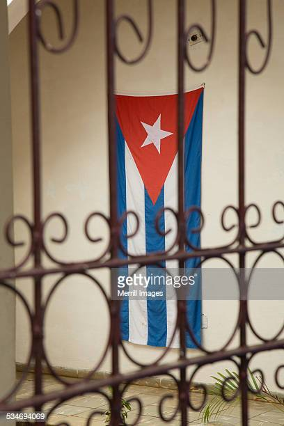 cuban flag and iron grill, vinales cuba - pinar del rio stock photos and pictures