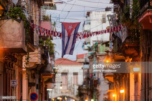 Cuban flag between Havana apartment buildings, Havana, Cuba